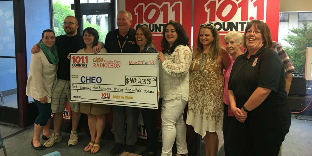 Country 101.1 Radiothon for CHEO holding cheque for over $40,000
