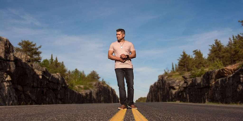 Canadian Country Artist Don Amero walking down the road