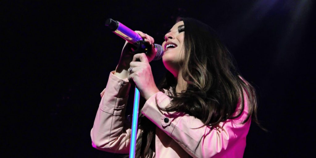 Jess Moskaluke singing on stage at Rogers Place in Edmonton