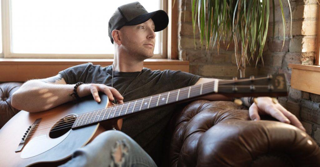 Tim Hicks with a guitar