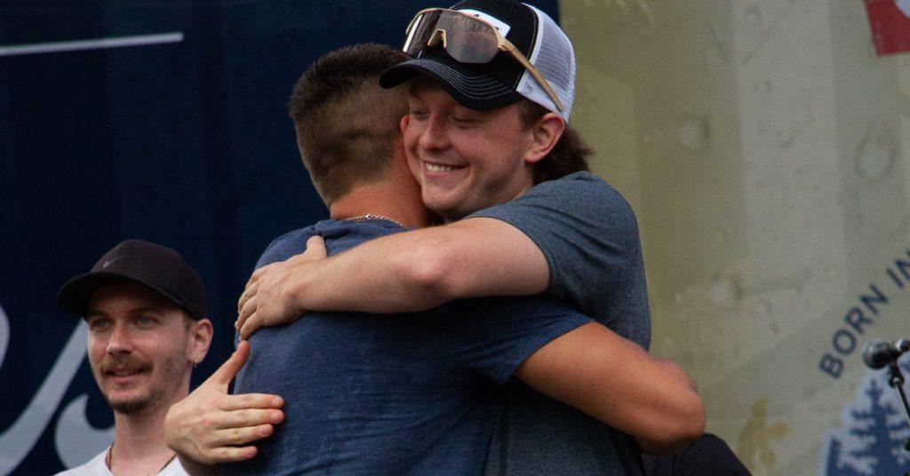 Riley Taylor and Andy Bast hug