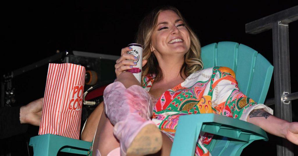 Kelly Prescott enjoying backstage
