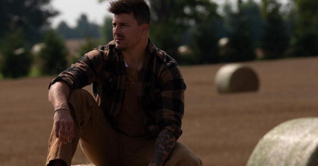 Ryan Connolly sitting on a hay bail